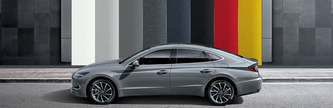 side view of a silver 2020 Hyundai Sonata against a backdrop of its available exterior colors