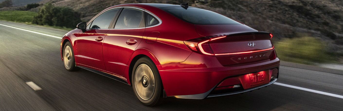 Red 2020 Hyundai Sonata drives up a highway