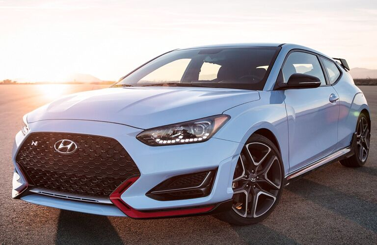 Side/front view of white Hyundai Veloster N