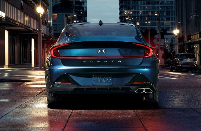 Rear end of a blue 2020 Hyundai Sonata, highlighting its own model name and LED taillights.