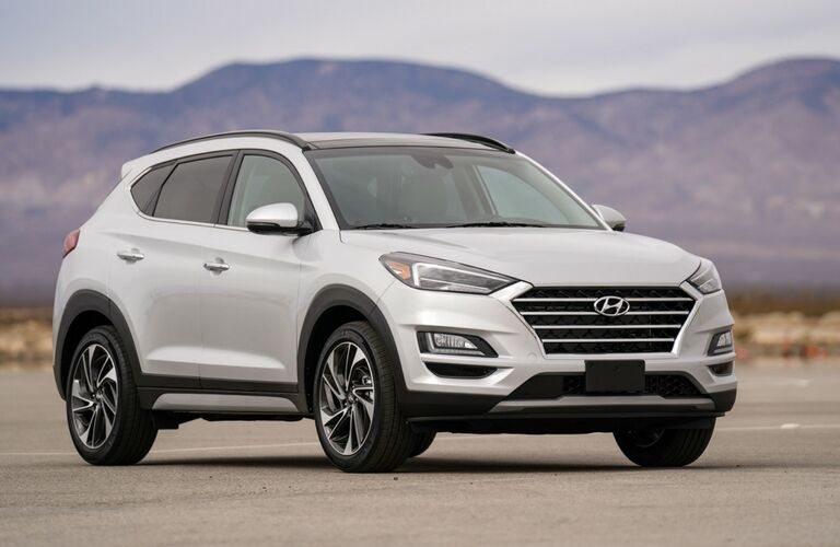 White 2020 Hyundai Tucson parked out in the desert, view of front.