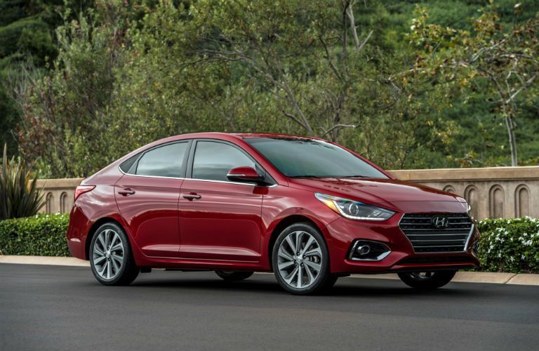 Side/front view of a parked red 2021 Hyundai Accent
