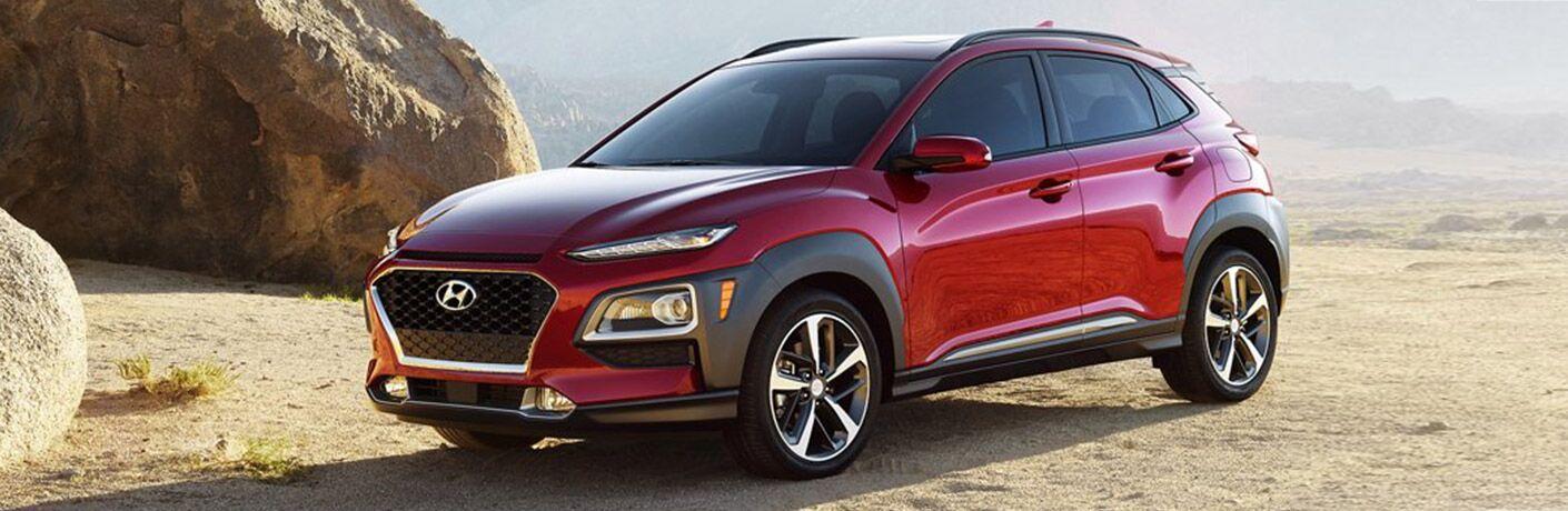 Red 2021 Hyundai Kona on a desert cliff