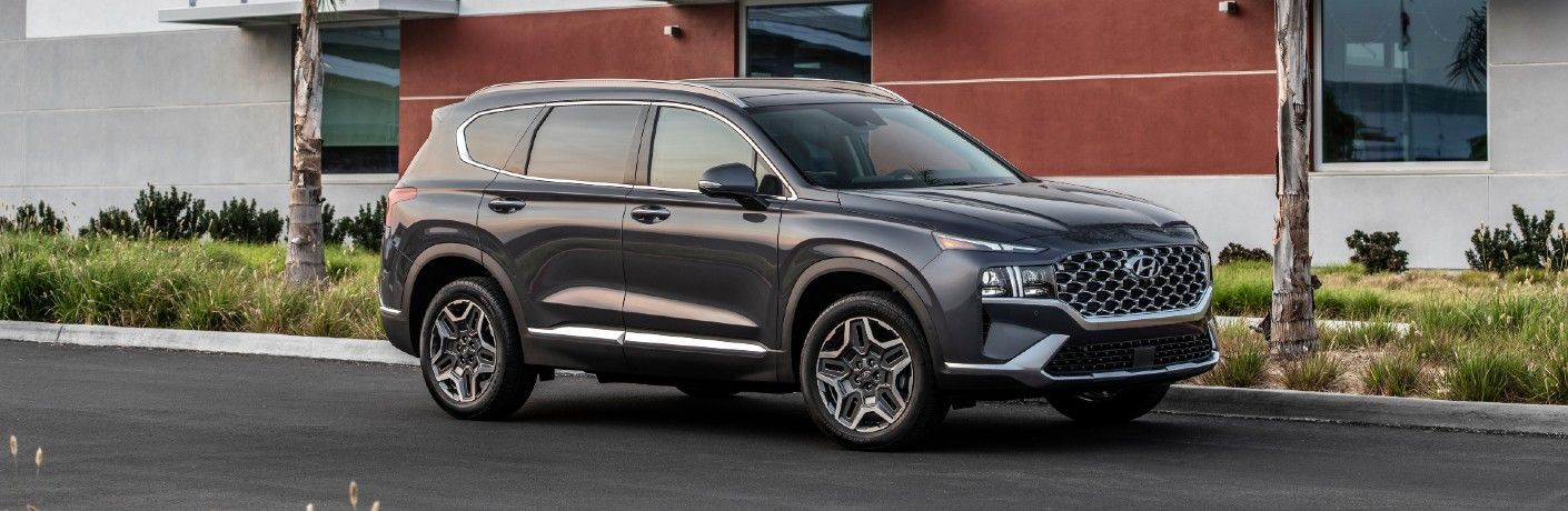 Black 2021 Hyundai Santa Fe parked beside a curb
