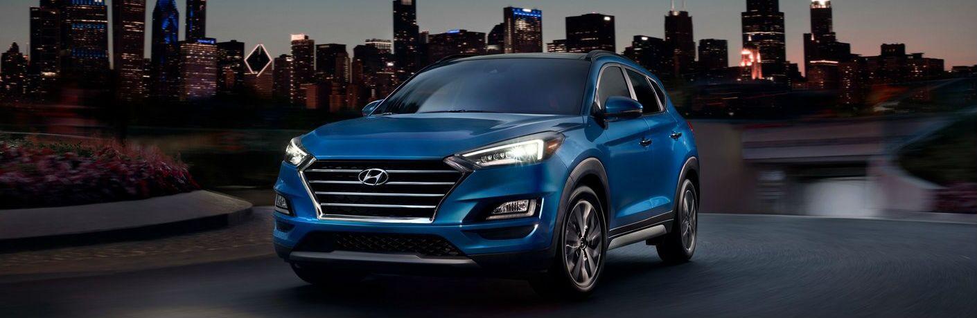 Blue 2021 Hyundai Tucson exterior front/side view