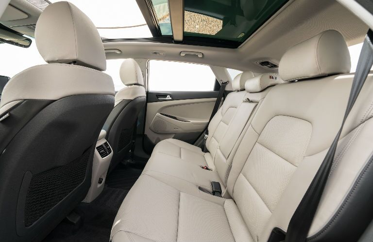 Side view of the rear seat inside a 2021 Hyundai Tucson