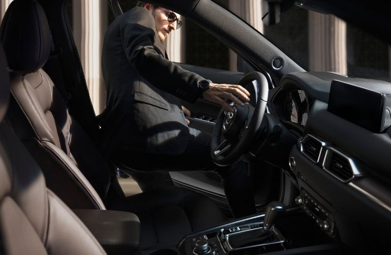 A person getting into 2021 Mazda CX-5