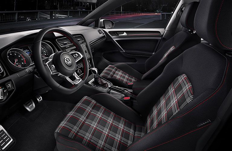 Interior cockpit of a 2020 Golf GTI with plaid seats