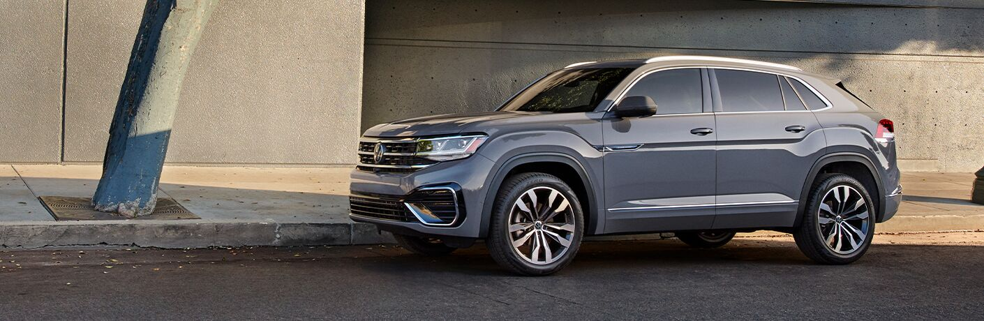 Gray 2021 Volkswagen Atlas Cross Sport parked by curb
