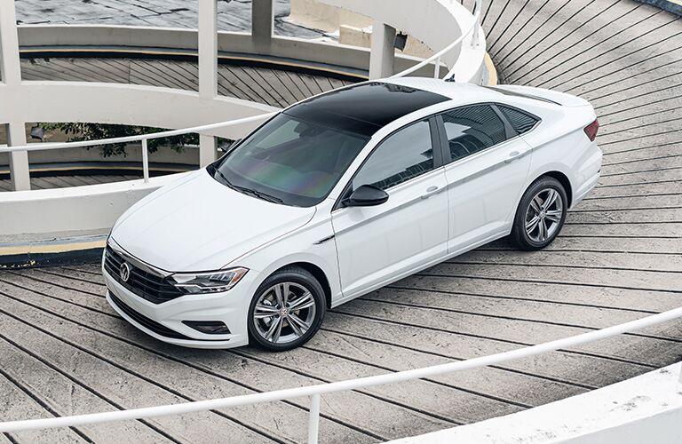 White 2021 Volkswagen Jetta rolls down a winding ramp