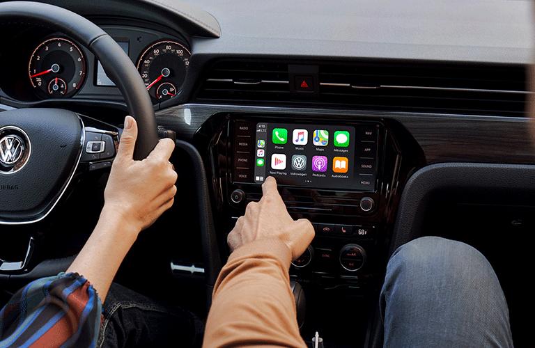 Passenger interacts with infotainment system inside 2021 Volkswagen Passat