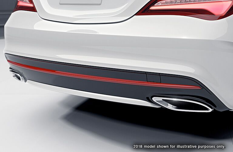 close up of the rear bumper and exhaust of a white 2018 Mercedes-Benz CLA Coupe