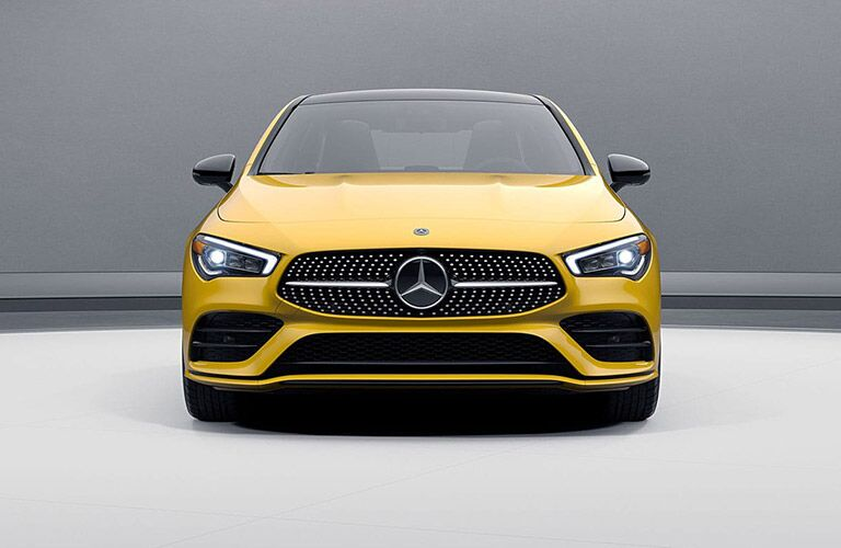 head-on view of a yellow 2020 mercedes-benz cla