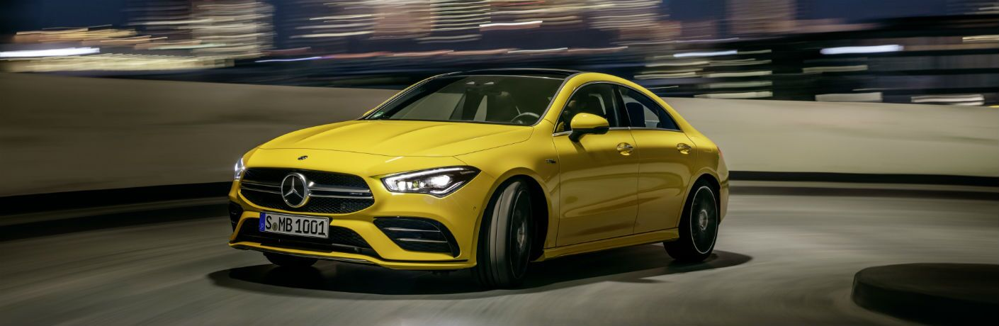 side view of a yellow 2020 Mercedes-Benz CLA Coupe