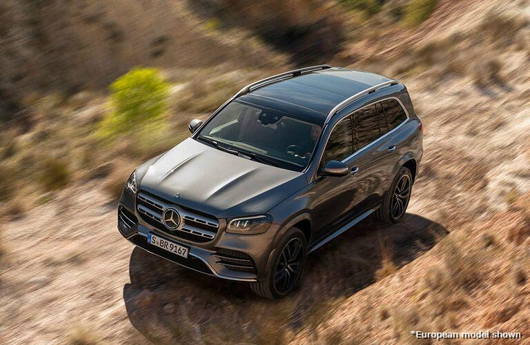 Exterior raised view of a 2020 Mercedes-Benz GLS driving through wilderness