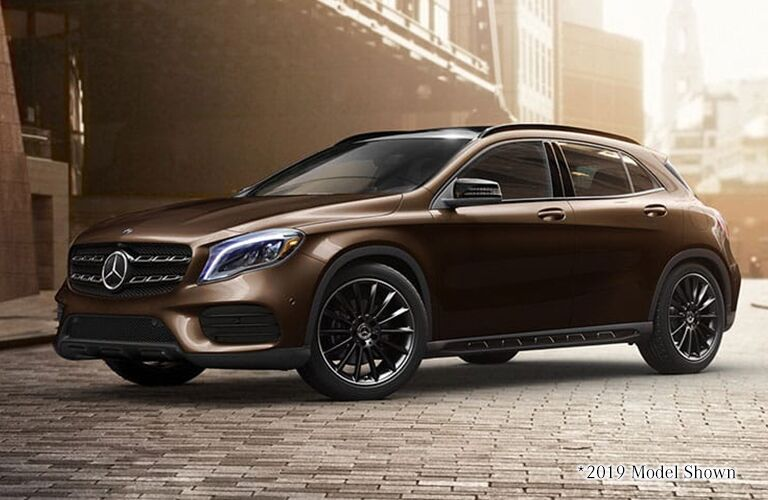 Caramel-colored 2020 Mercedes-Benz GLA SUV parked in a strange, ancient looking city.