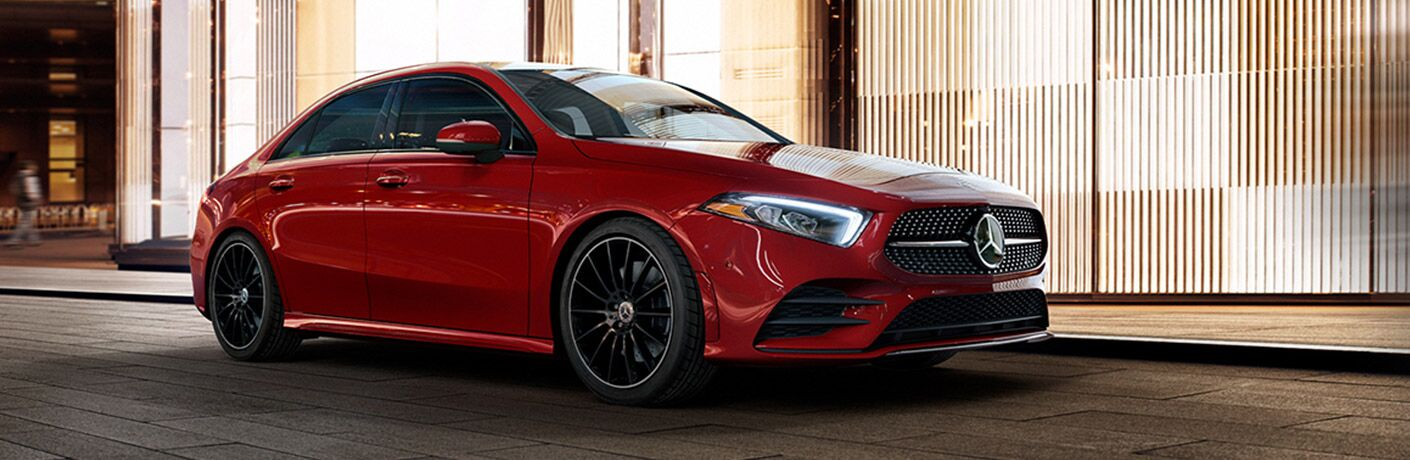 Red 2021 Mercedes-Benz A 220 Sedan by a building