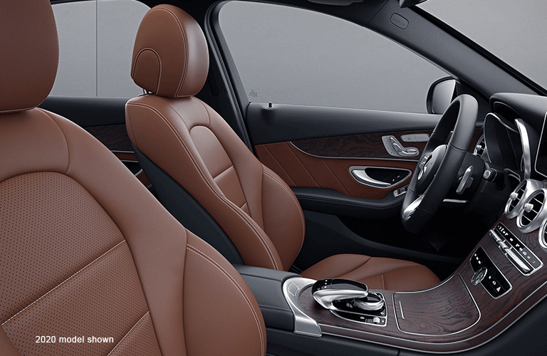 """Side view of the front seat inside a Mercedes-Benz C-Class. Text reads, """"2020 model shown"""""""