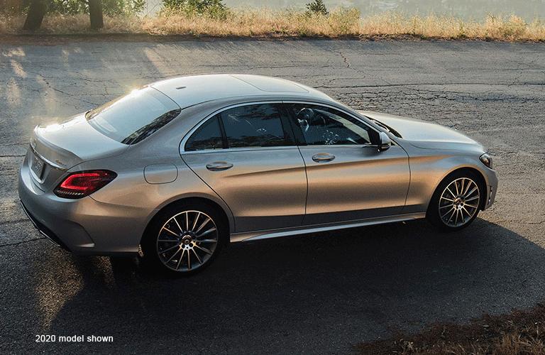 """Mercedes-Benz C-Class drives along path. Text reads, """"2020 Model Shown"""""""