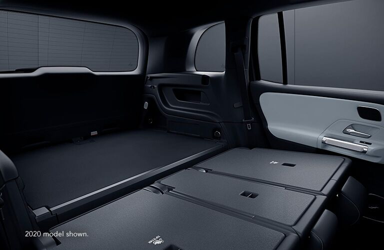 "Cargo area with rear seats folded down in Mercedes-Benz GLB. Text reads, ""2020 model shown."""
