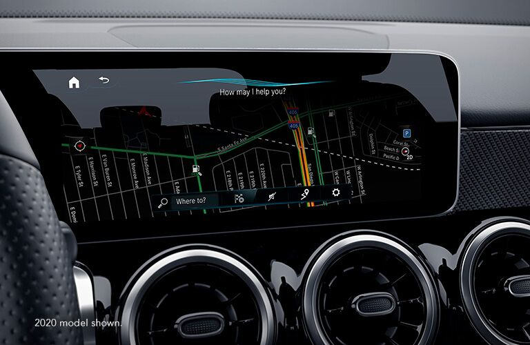 "Infotainment screen inside Mercedes-Benz GLB. Text reads, ""2020 model shown."""