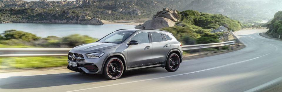 Silver 2021 Mercedes-Benz GLA drives along a highway