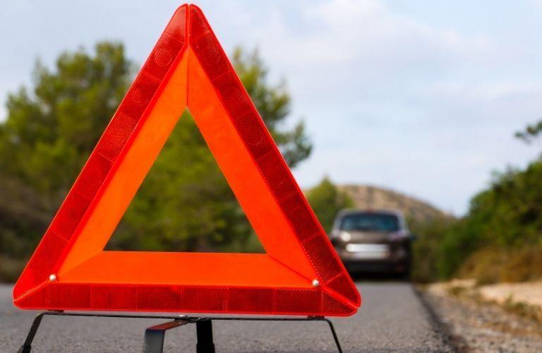 A triangular roadblock sign