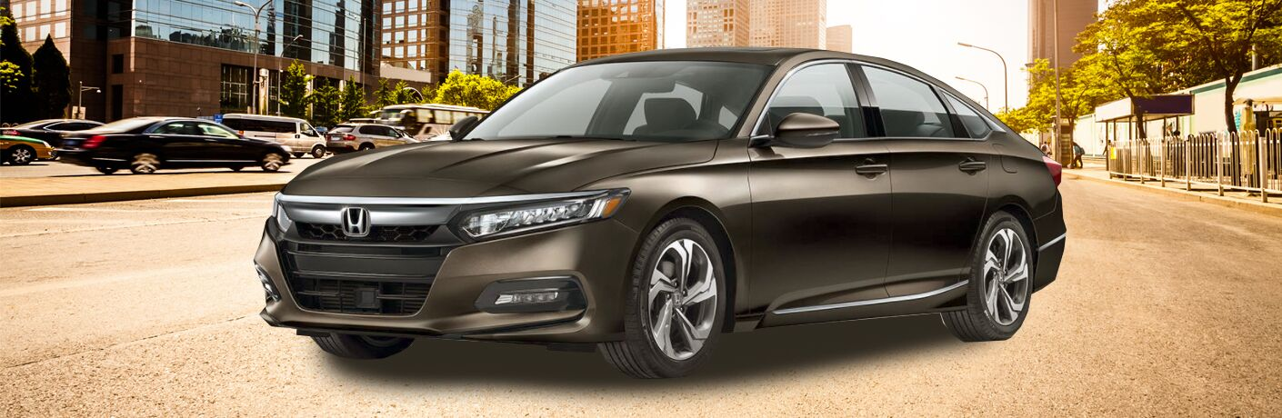 Front quarter profile of the 2018 Honda Accord parked in a lot in a busy city