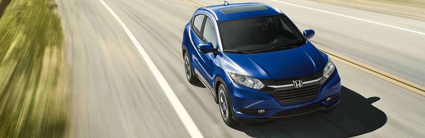 front view of blue 2018 Honda HR-V driving along highway