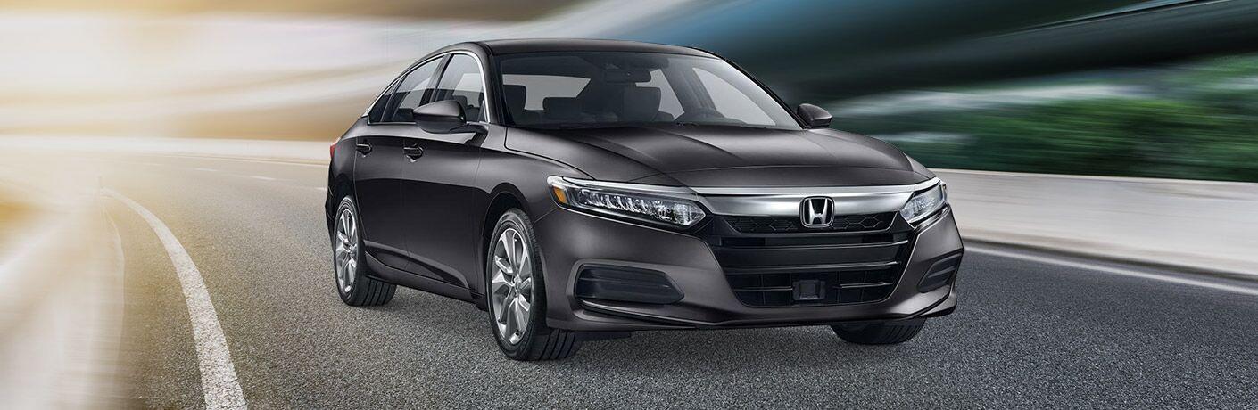 2019 Honda Accord driving down a winding road