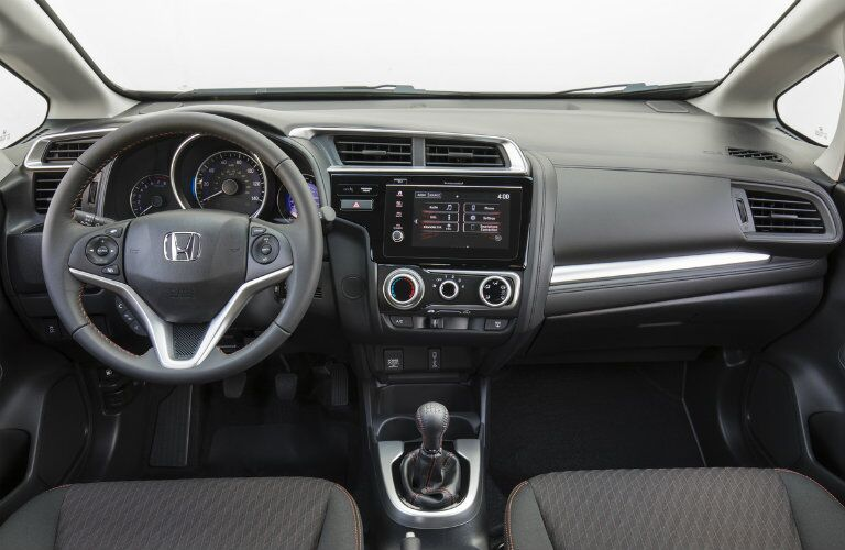 Steering wheel and touch screen inside the 2019 Honda Fit