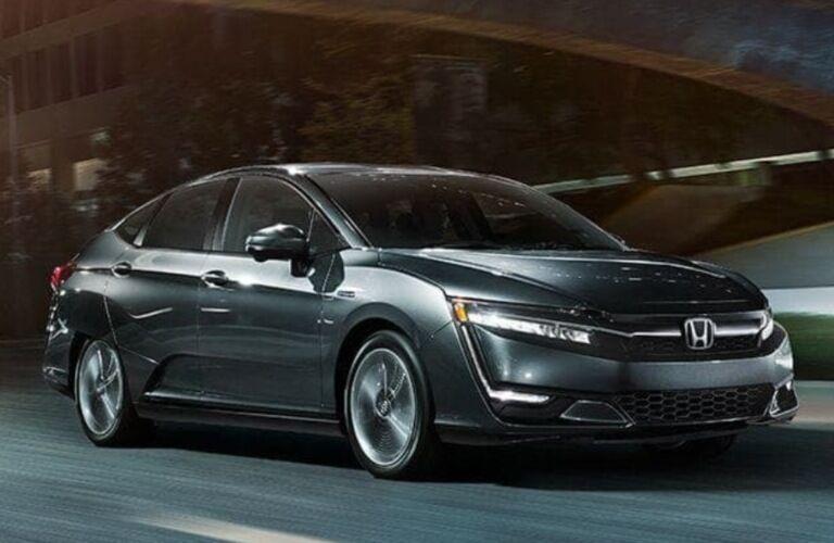 2019 Honda Clarity Plug-In Hybrid driving down a dark city street