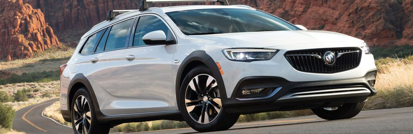 2019 Buick Regal TourX white driving up hill