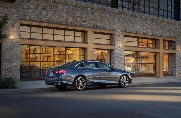 2019 Chevrolet Malibu exterior back fascia and passenger side parked outside building