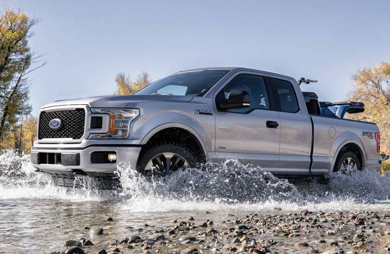 2018 Ford F-150 side driving through water