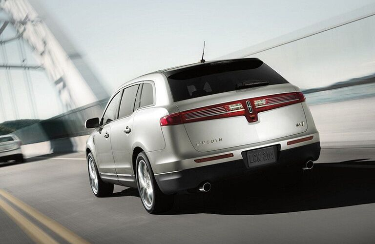 2018 Lincoln MKT exterior back fascia and drivers side going fast on road