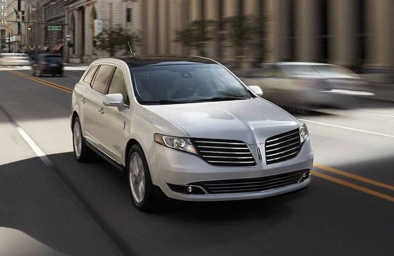 2018 Lincoln MKT exterior front fascia and passenger side going fast on blurred road