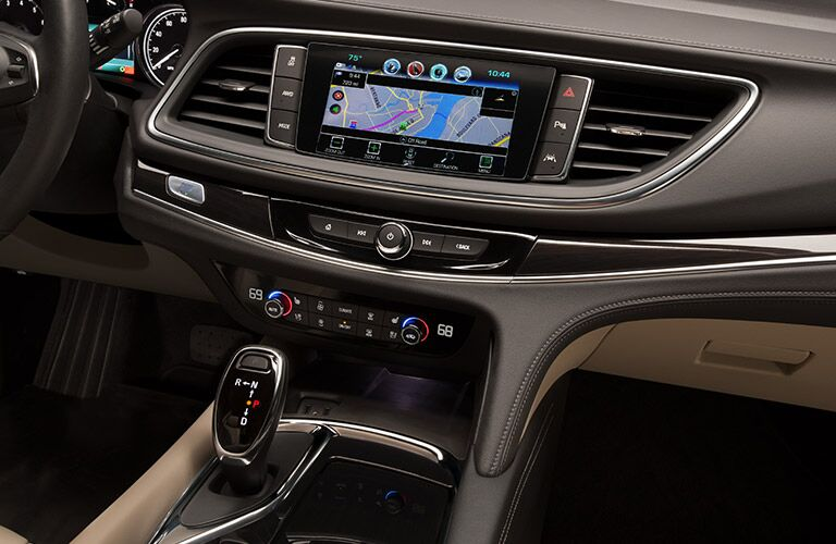2019 Buick Enclave interior front cabin close up of gear shift and touchscreen display partial steering wheel