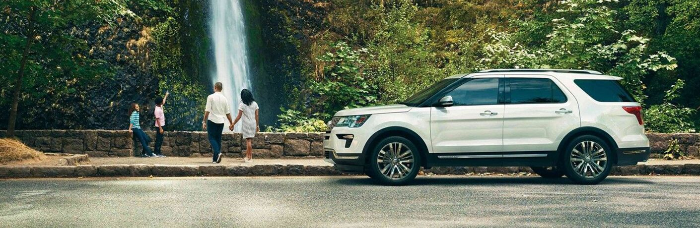2019 explorer parked in front of waterfall