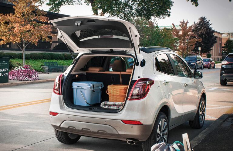 Open liftgate of the 2020 Buick Encore with items in the cargo area