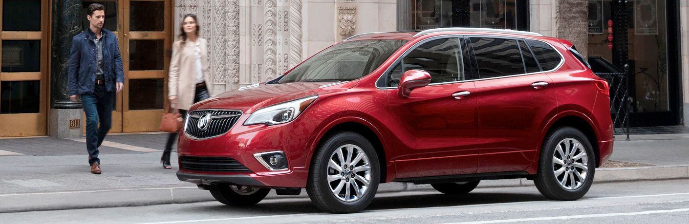 Red 2020 Buick Envision parked outside a bank