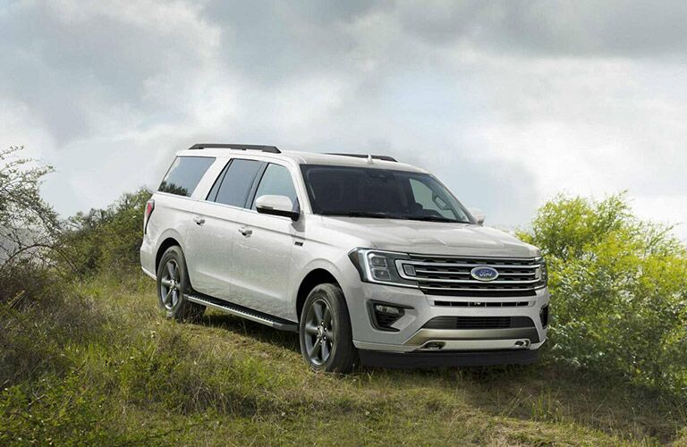 White 2020 Ford Expedition driving through grass