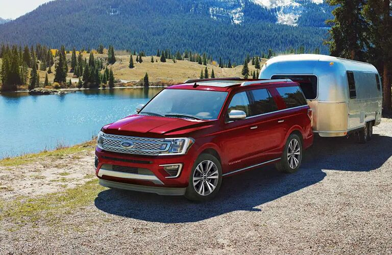 Red 2020 Ford Expedition hauling a trailer on road
