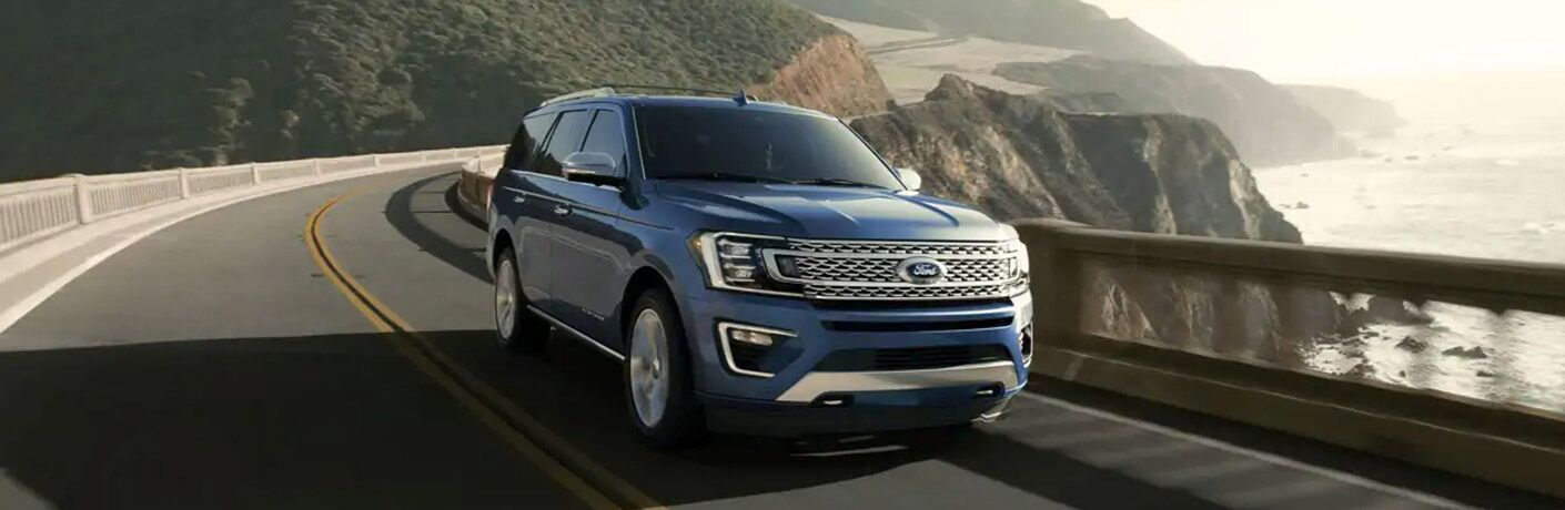 Blue 2020 Ford Expedition driving on roadway