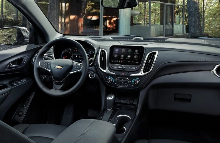 Interior view of the front seating area inside a 2021 Chevrolet Equinox