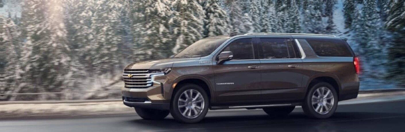 2021 Chevrolet Suburban side view on a winter road