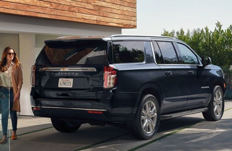 2021 Chevrolet Suburban rear view with a person