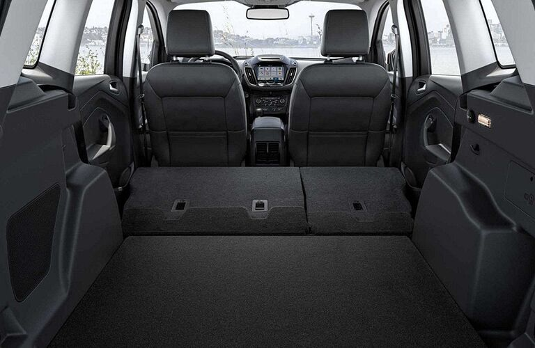 storage space shown with seats down in 2018 ford escape through open rear liftgate