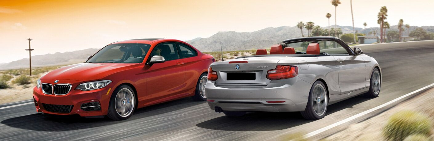 2017 BMW 2 Series coupe and convertible crossing paths on a street
