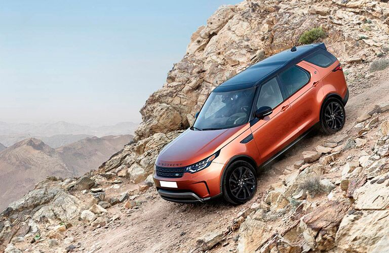 2017 Land Rover Discovery climbing down a steep rocky slope